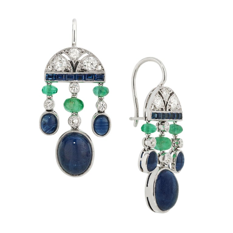 These gorgeous earrings were imagined by the designer alongside a 5-strand necklace also in Sapphires and Emeralds to be found in another listing.  The top of the earrings feature an Art Deco Design in Diamonds and is finished with a line of French