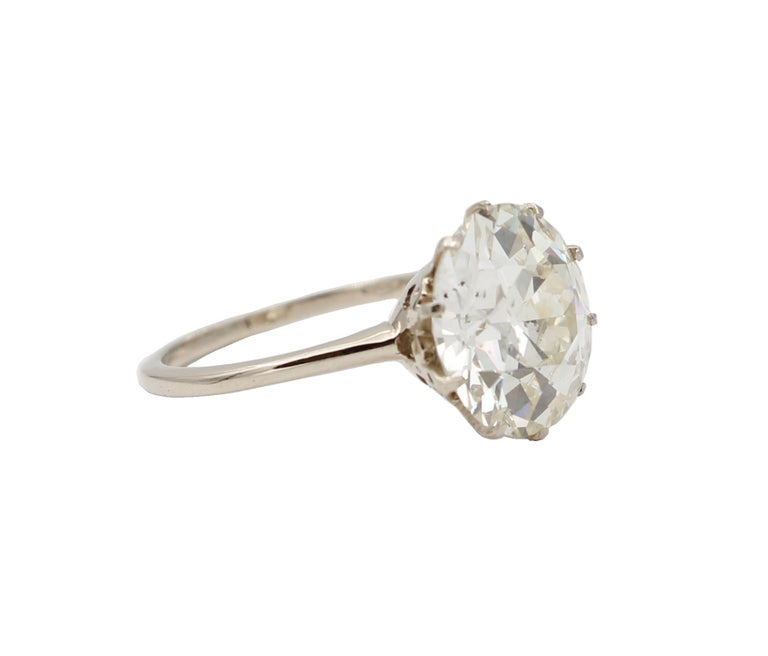 Magnificent solitaire/engagement ring realized in 18kt white gold with a simple design! It's mounted with a special diamond (old cut) of 6,60 ct (with certificate) The origin of this ring dates probably back to the 1920s, it was totally handmade by