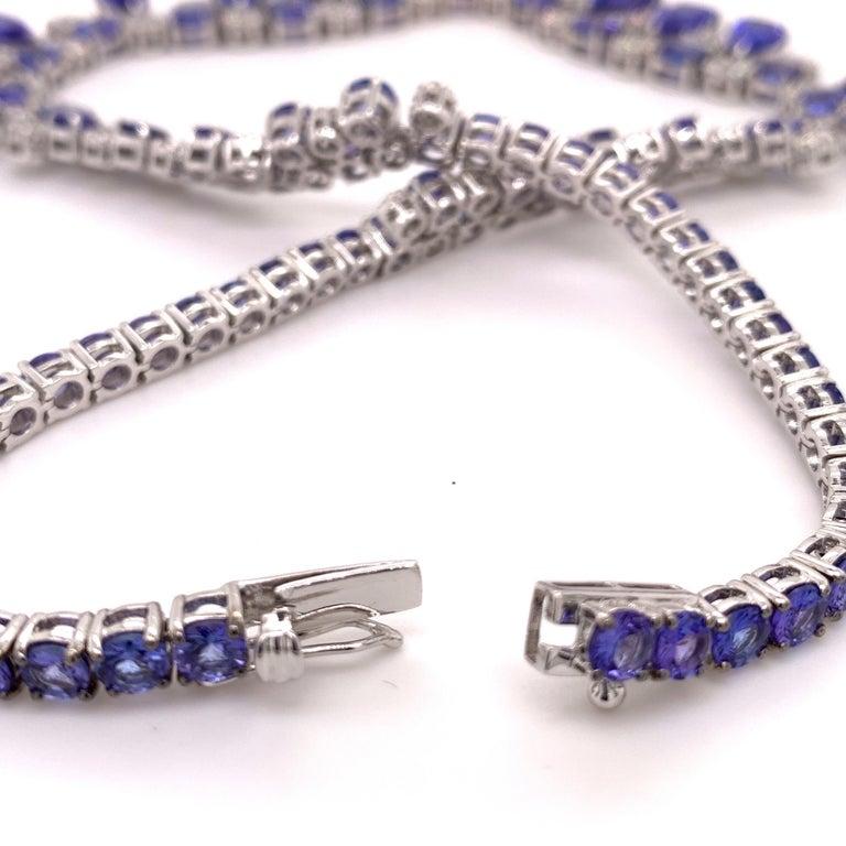 Pear Cut 66.36 Carat Tanzanite Necklace Earrings Set For Sale