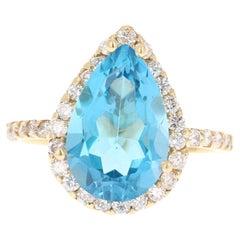 6.68 Carat Blue Topaz Diamond 14 Karat Yellow Gold Ring