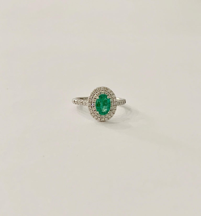 This stunning AAAA Oval Emerald is of a bright green colour which is set off spectacularly by the double halo of diamonds.  The ring could make an amazing Engagement ring but would just as well make a beautiful Cocktail RIng.  The 0.66ct Emerald