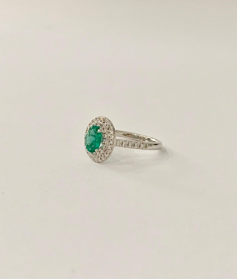 Modern .66 Carat AAAA Oval Emerald Set in Double Diamond Halo Ring in 18ct White Gold For Sale