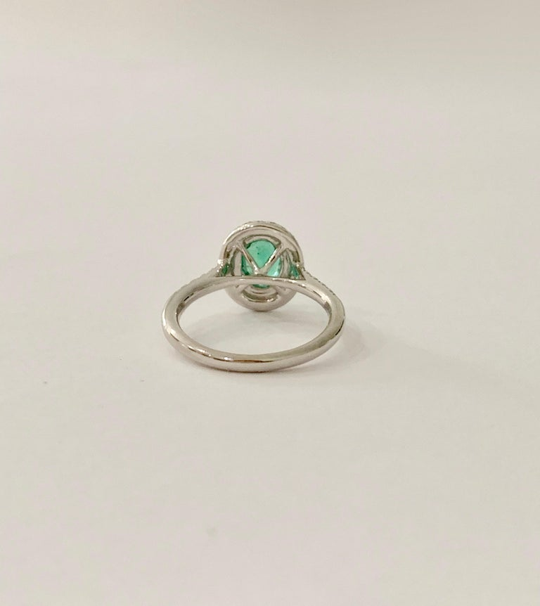 Oval Cut .66 Carat AAAA Oval Emerald Set in Double Diamond Halo Ring in 18ct White Gold For Sale