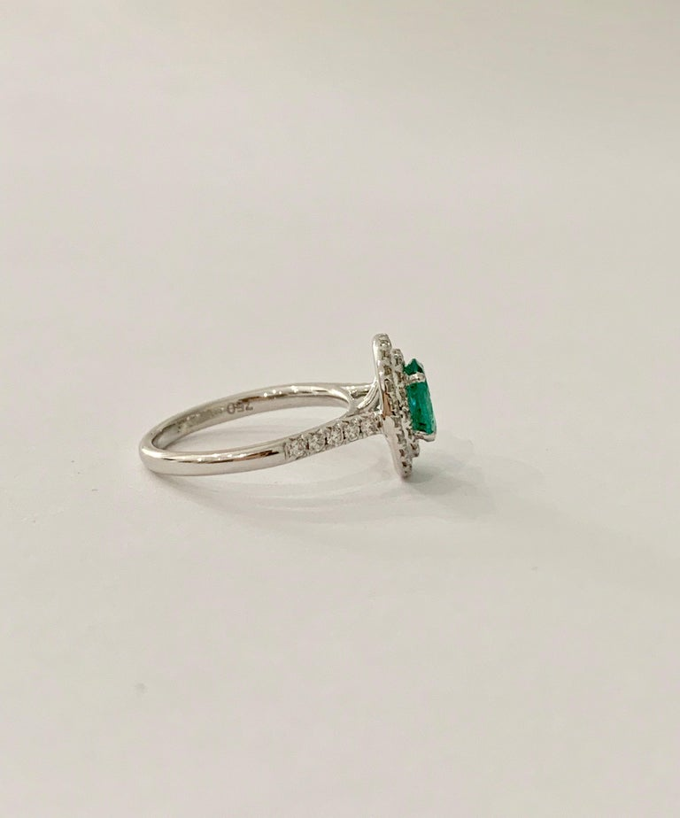 .66 Carat AAAA Oval Emerald Set in Double Diamond Halo Ring in 18ct White Gold In New Condition For Sale In Chislehurst, Kent
