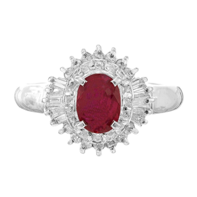 Oval ruby and diamond halo engagement ring. GIA certified .67 carat natural corundum oval center ruby with a halo of baguette and around diamonds in a custom-made platinum setting.   1 oval red ruby, SI approx. .67cts GIA Certificate #6217312015 10