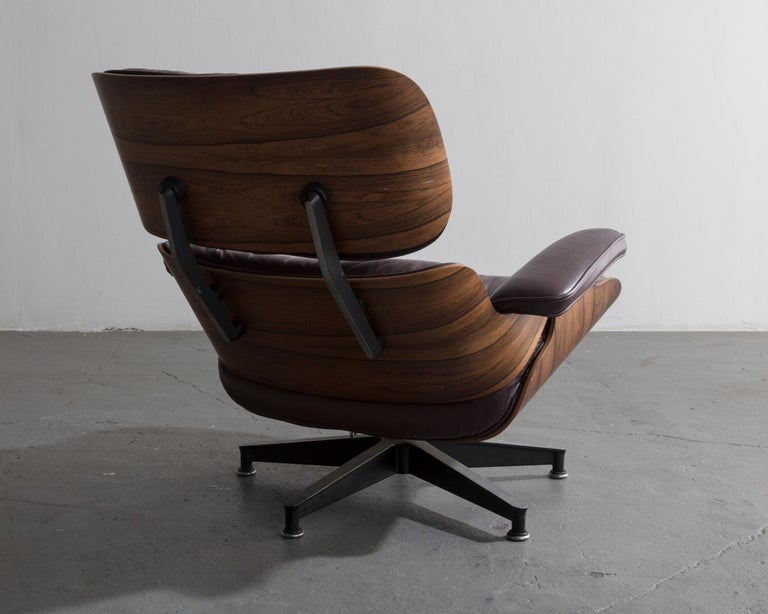 American 670 Lounge Chair & Ottoman in Rosewood & Leather by Charles and Ray Eames, 1958 For Sale
