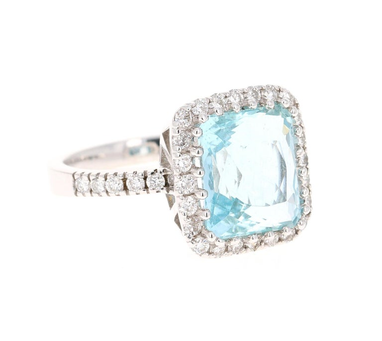 This ring has a 5.98 Carat gorgeous Aquamarine and is surrounded by 34 Round Brilliant Cut Diamonds that weigh 0.74 Carats. The Clarity of the Diamonds is a VS and the Color is F.  The total carat weight of the ring is 6.72 Carats.  The ring is