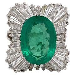 6.72 Carat Emerald with Ballerina Baguette Diamond Halo Ring 18 Karat White Gold
