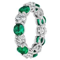 6.73 Carat Emerald and Round Diamond Eternity Band Ring