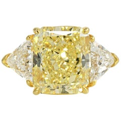 6.76 Carat Radiant Cut Fancy Yellow VVS2 Diamond Three-Stone Engagement Ring