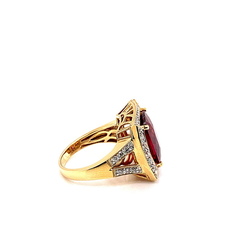 Contemporary 6.77 Carat Oval Shaped Rubelite Ring in 18 Karat Yellow Gold with Diamonds For Sale