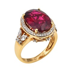 6.77 Carat Oval Shaped Rubelite Ring in 18 Karat Yellow Gold with Diamonds