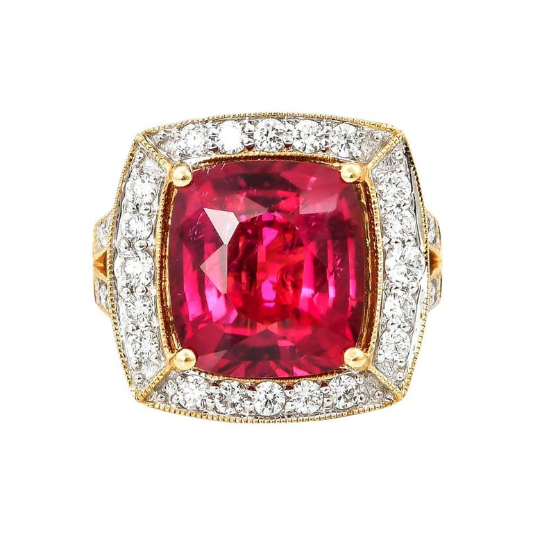 6.77 Carat Oval Shaped Rubelite Ring in 18 Karat Yellow Gold with Diamonds For Sale