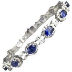 DiamondTown 6.79 Carat Oval Vivid Blue Sapphire and 4.69 Carat Diamond Bracelet