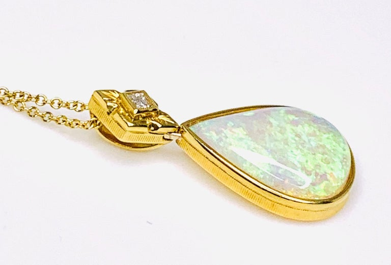 6.83 Carat Pear Shape Opal and Diamond 18 Karat Yellow Gold Pendant In New Condition For Sale In Los Angeles, CA