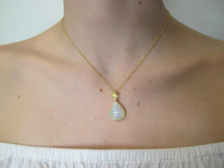 This  opal pendant is like a kaleidoscope of color! Multicolor