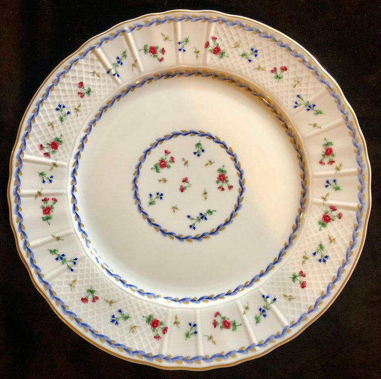 Bernardaud limoge Artois blue or green dinnerware with tea cups and saucers, (1974-2006) Decorated with laurel wreath and flowers, gold rim on Versailles shape. This fine complete service for 11 (with extras) dinner set was discontinued in 2006.