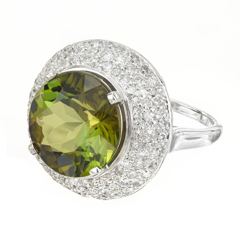 1950's mid-century Tourmaline and diamond cocktail ring. 6.90ct round center bi-color green tourmaline in a platinum setting with a halo of 96 diamonds, totaling 1.65cts.   1 round green brown tourmaline, VS approx. 6.90cts 96 round diamonds, G-H