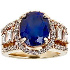 6.95 Carat Oval Tanzanite and Baguette Diamond Antique Ring in 14 Kt Yellow Gold