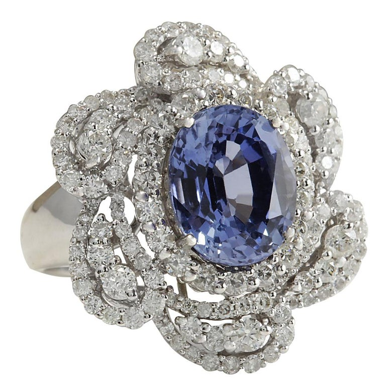 Stamped: 18K White Gold  Total Ring Weight: 11.0 Grams  Ring Length: N/A  Ring Width: N/A  Gemstone Weight: Total  Ceylon Sapphire Weight is 5.10 Carat (Measures: 11.12x9.09 mm)  Color: Blue  Diamond Weight: Total  Diamond Weight is 1.86