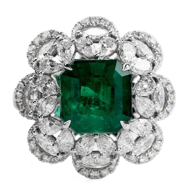 Treat yourself to this irresistibly stunning Diamond Colombian Emerald 18K Gold Large Cocktail Ring! This ring is  crafted in 18 karat white gold. The center gemstone is one square emerald cut, bezel set, genuine deep green  Colombian Emerald