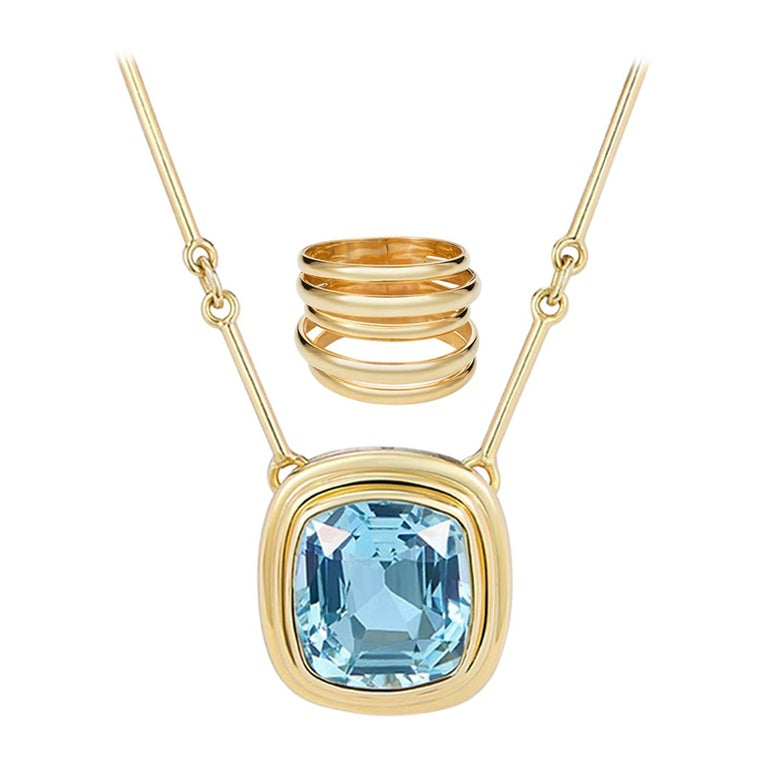 6.97 Carat Cushion Cut Aquamarine Necklace, 5 Band Gold Ring Suite For Sale