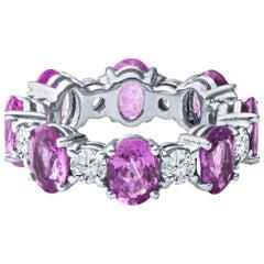 6.98 Carat Oval Pink Sapphire & 1.55 Carat Round Diamond 14kt Gold Eternity Band