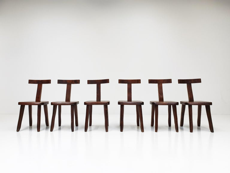 A set of 6 robust sculptural brutalist solid elmwood chairs with hand chiselled detail. Designed by Olavi Hänninen for Mikko Nupponen, Finland, 1950.  The condition of the chairs is good with levels of wear well within what is commensurate for