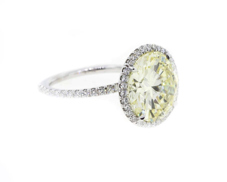 Contemporary 7 Carat Fancy Yellow Round Diamond Engagement Ring in Platinum For Sale