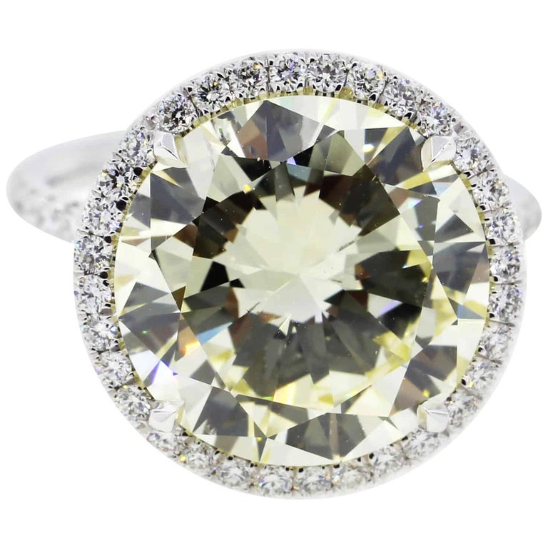 7 Carat Fancy Yellow Round Diamond Engagement Ring in Platinum For Sale