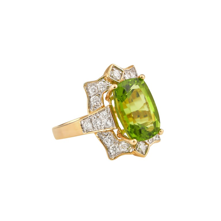 This collection features an array of pretty peridot rings! Accented with diamonds these rings are made in yellow gold and present a vibrant and fresh look.   Classic peridot ring in 18K yellow gold with diamonds.   Peridot: 7.01 carat cushion