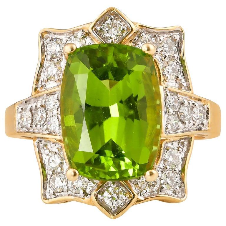 7 Carat Peridot and Diamond Ring in 18 Karat Yellow Gold For Sale