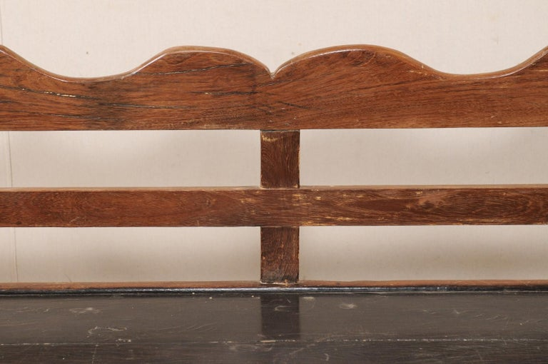 7 Ft Long Mid 20th C. Brazilian Peroba Wood Bench with Nicely Carved Back Rail  For Sale 1