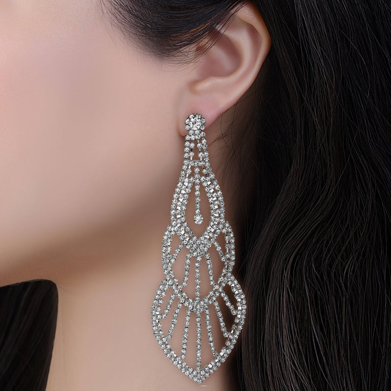 These earrings are very unique and 6.75 Inches long! The diamonds droop all the way down past your shoulder to create a sense of awe. We made the most unique diamond earrings for the woman who wants to be seen on the red carpet with a pair of
