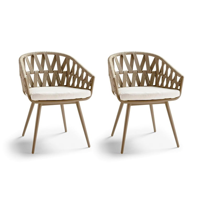 Featuring 7 pieces, this contemporary outdoor collection features a dining table crafted of teak wood and all-weather resistant aluminum framed chairs.  Each chair is wrapped in synthetic rope in a tasteful, artistic open design for more air