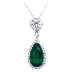 7.00 Carat Pear Shape Emerald Pendant in 18K Gold with 1.85 Carat Diamonds Halo