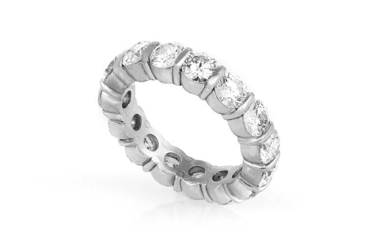 Estate Platinum Eternity Ring features 15 round brilliant cut diamonds, weighing a total of 7.00carats. Ring Size 8. May be sized upon request, Additional charges may apply. Circa 1990's.