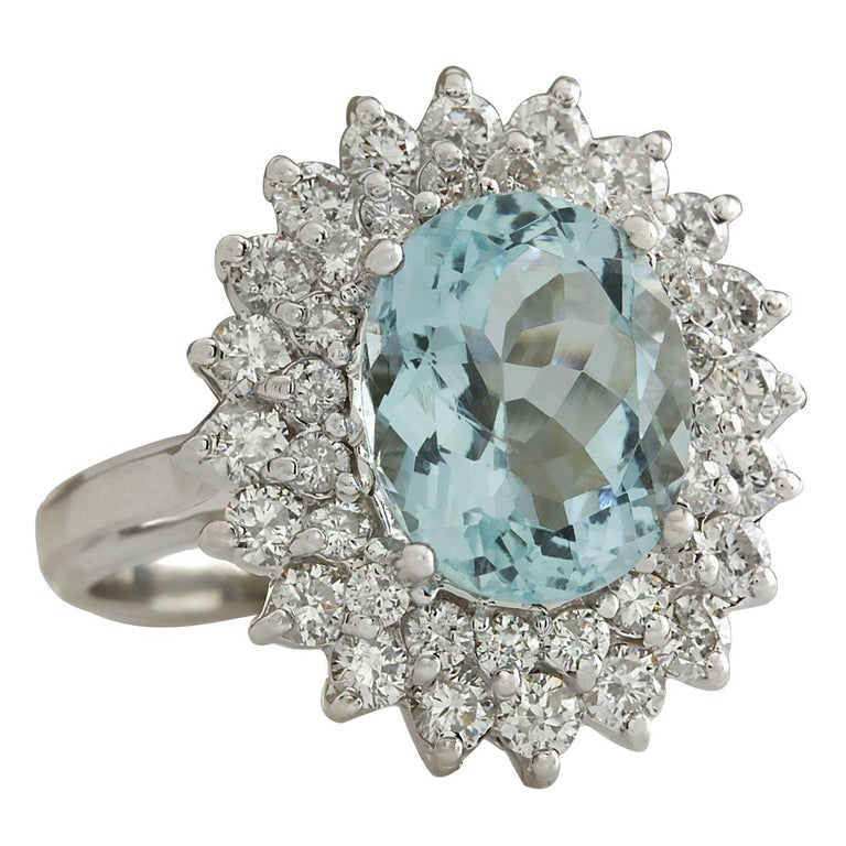 Stamped: 18K White Gold Total Ring Weight: 6.8 Grams Ring Length: N/A Ring Width: N/A Gemstone Weight: Total Natural Aquamarine Weight is 5.41 Carat (Measures: 11.12x9.02 mm) Color: Blue Diamond Weight: Total Natural Diamond Weight is 1.62