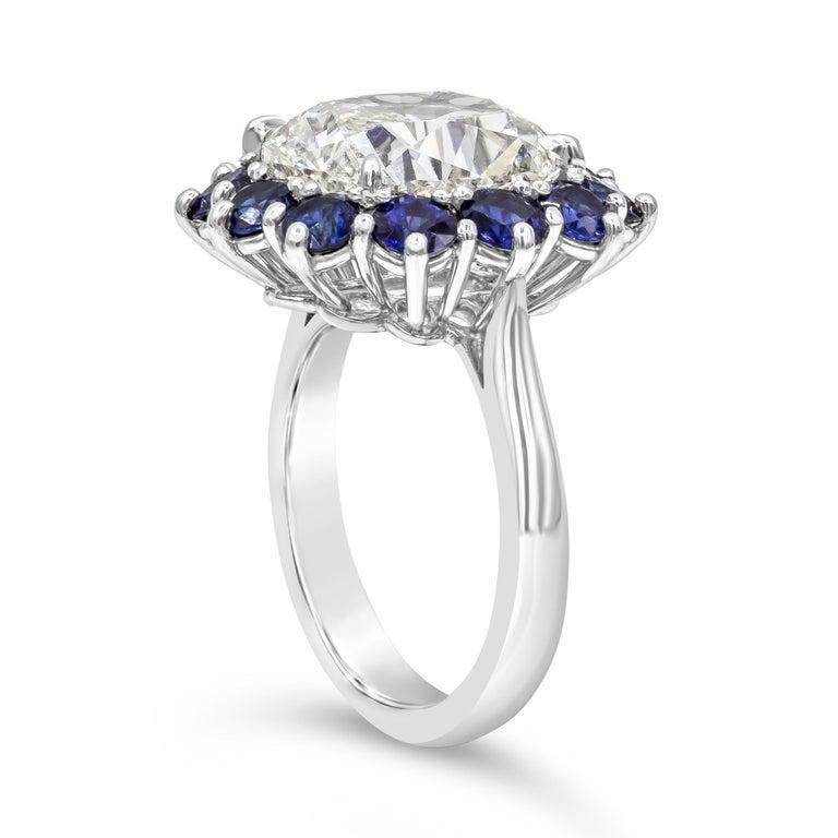 Contemporary Roman Malakov GIA 7.04 Carat Cushion Cut Diamond and Blue Sapphire Halo Ring For Sale