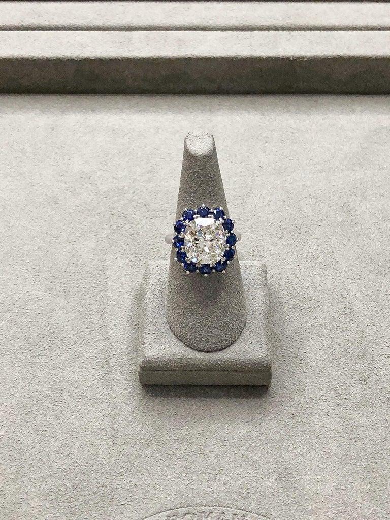 Roman Malakov GIA 7.04 Carat Cushion Cut Diamond and Blue Sapphire Halo Ring For Sale 2
