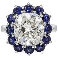 7.04 Carat Cushion Cut Diamond and Blue Sapphire Halo Ring