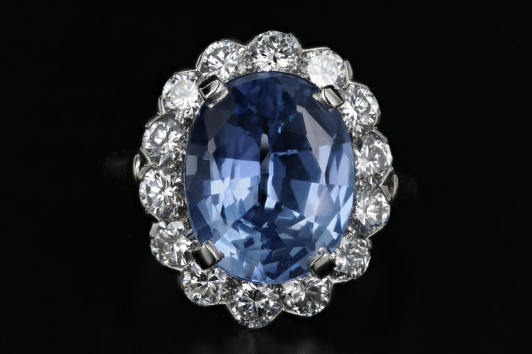 Era: Modern  Hallmarks: Plat  Composition: Platinum  Primary Stone: Cornflower Blue Ceylon Sapphire  Stone Carat Weight: 7.04 Carats  Accent Stone: Diamonds  Accent Stone Carat Weight: 1.5 Carats  Color/ Clarity: F-G / VS1-2  Ring Length: 18.42