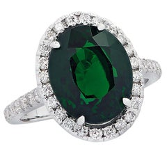 7.07 Carat Tsavorite and Diamond Halo Ring