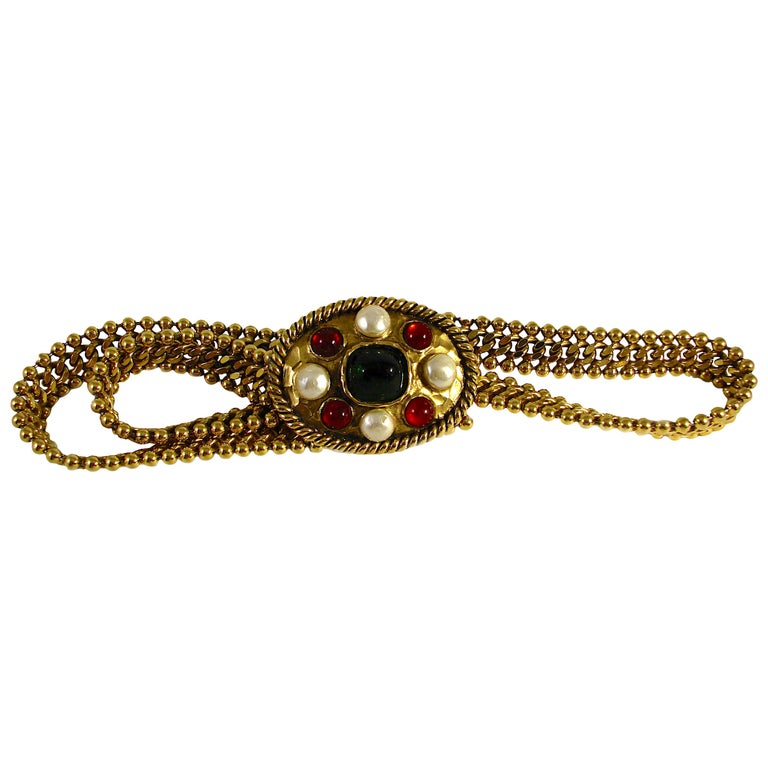 This fabulous belt was made by Robert Goossens for Chanel in the early 1970s and was acquired from the estate of a former Chanel employee. Made from gilt metal, the buckle features red & green pâte de verre (poured glass) stones with four cream