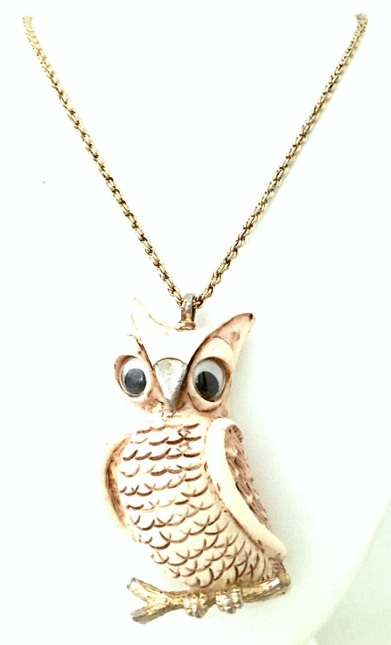1970'S Gold & Resin Owl pendant Necklace By. Lucca Razza. The large own pendant is sculpted from resin composite with plastic eyes and gold plate in the beak, bale and lower faux bois branch. This rare and coveted piece Includes a 36.5