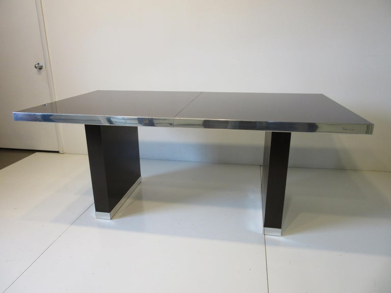 A large rich chocolate brown dining table with one 18
