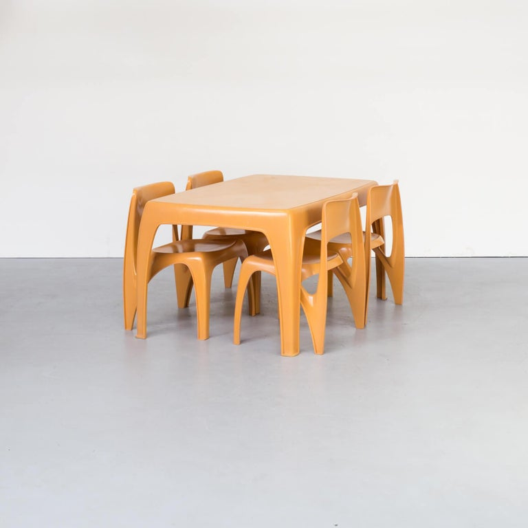 1970s Preben Fabricius design dining table set for Interplast. Made of fiberglass table and four chairs in brown/orange/terra color. Very rare set in good condition consistent with age and use.