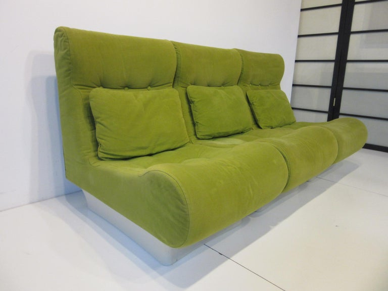 A well-constructed 3 piece loveseat, sofa with matching back pillows, off-white fiberglass bases and stitched design to the seats. The individual sections can be used as lounge chairs when not together and are extremely comfortable covered in a soft