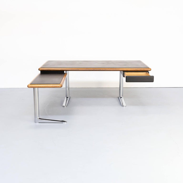In 1973, Knoll introduced The Platner Executive Office Collection. The thin profile executive desk featured a bullnose oak perimeter with black leather writing surface, supported by polished chrome legs and extended feet. Drawers of varying sizes