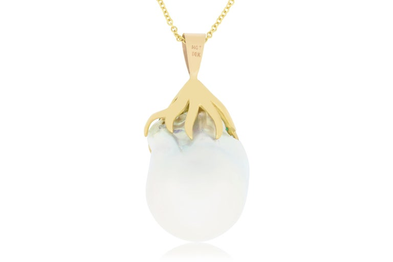This unique piece features a pearl center stone descending from stones of Emerald and Diamond. Perfect for colored jewelry lovers everywhere!  Material: 18K Yellow Gold Center Stone Details: 1 Pearl at 7.11 carats Mounting Stone Details: 19 Emeralds